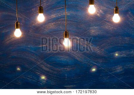 Incandescent Lamps In A Modern Studio On Blue Background. Edison Lamp.
