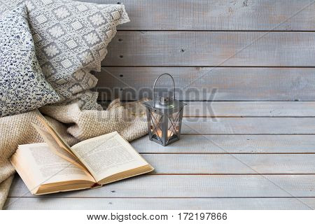 Cushions, Plaid, Christmas Lantern And Old Book On The White Wooden Background, Closeup.