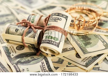 Golden jewellery and dollars. Luxury present for woman.