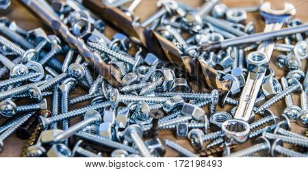 tapping screws made od steel, metal screw, iron screw, chrome screw, screw as a background, wood screw, nuts,
