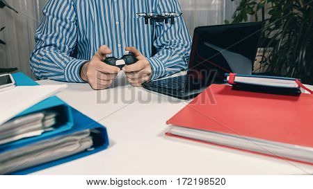 Businessman Testing New Toy On Desk In Office. Office Playing.