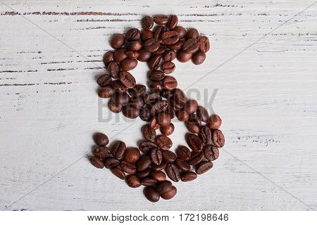 Roasted coffee beans. Investment in your future.