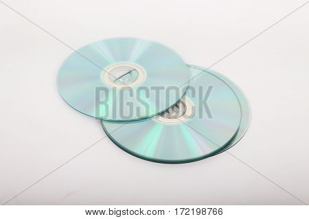 CDs to record information placed on a white background.