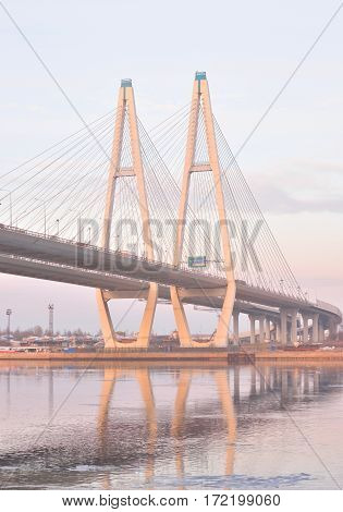 Cable stayed bridge and Neva river on the outskirts of St. Petersburg at cloud spring evening Russia.