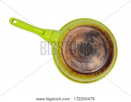 Dirty frying pan isolated on white
