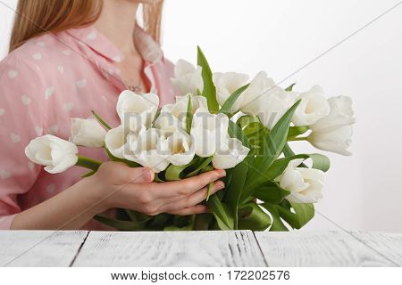 girl with a bouquet of tulips bestowed