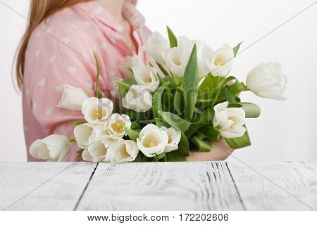 Girl Has Just Bestowed A Bouquet Of White Tulips