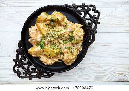 Hot Potatoes And Red Fish In Creamy Sauce On A White Wooden Background