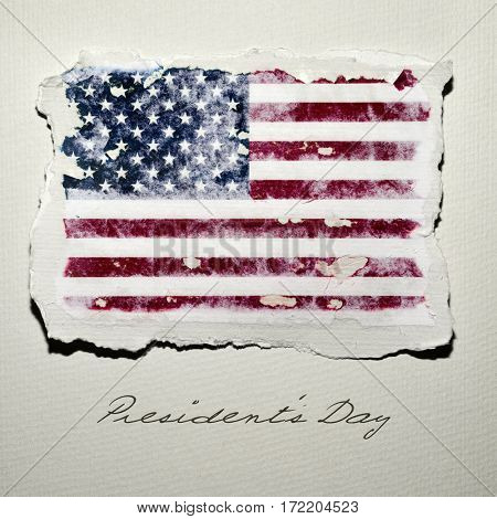the flag of the United States in an aged piece of paper and the text presidents day on an off-white background