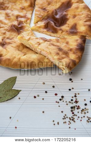 Ossetian baked pie with cheese and salmon fish