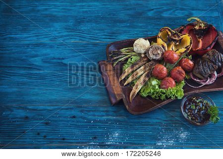 Grilled vegetable on a blue wooden background