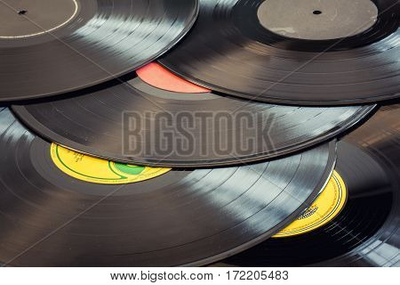 A background of ssorted old school dusty vinyl records
