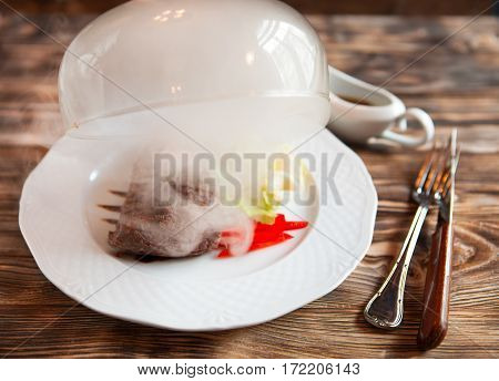 Female Hand Lifts To Up Cloche  From A Plate With Hot Food At Restaurant -  Food Time!