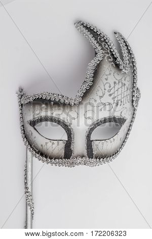 Elegant carnival mask on white background. Top view