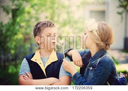 Young Boy and Girl Talking in the Spring. Carefree Children Outdoors