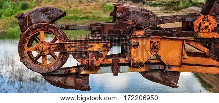 Old rusty multi bucket excavator giant stacker absetzer in career.