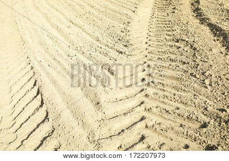 Wheel tracks on the ploughed field. Close-up.