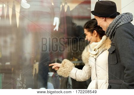 Young couple looking at shop display