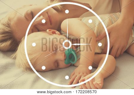 Time concept. Little baby boy sleeping with mother on bed