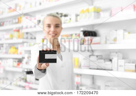 Female shop assistant with cardboard package at work