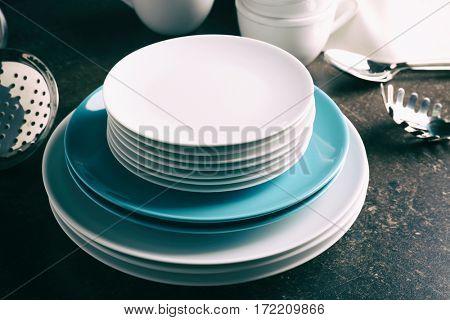 Set of ceramic dishes on dark table