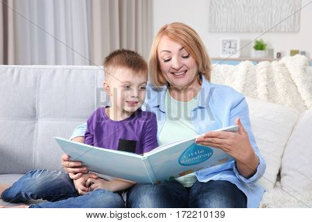 Grandmother reading her grandson book