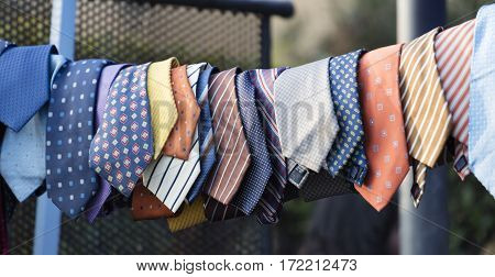 hanging colored vintage ties in a row