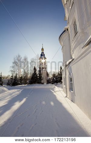 Kazan, Russia, 9 february 2017, Zilant monastery - oldest orthodox building in front of the sun, vertical