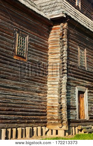 Ancient wooden church (XVIII century) from the Northern Ukraine in the open-air Museum of Folk Architecture near Kyiv. The wall. Close-up.