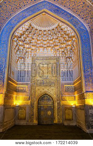 SAMARKAND UZBEKISTAN - OCTOBER 15 2016: Interior of the mosque Tilya Kari Madrasah on Registan Square Mihrab