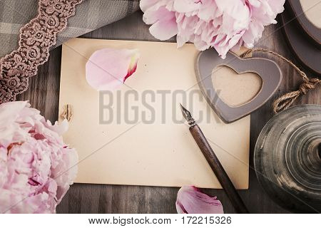 Old Blank Paper Background with Flowers Love Heart Pen and Lace. Top View