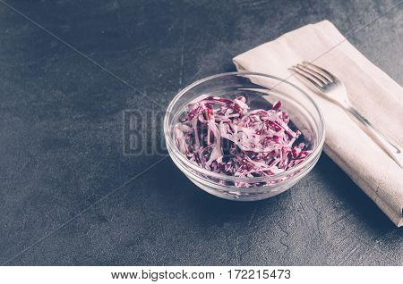 Red Cabbage In A Glass Dish On A Dark Background