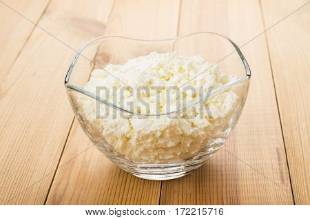 Transparent Bowl With Cottage Cheese On Table