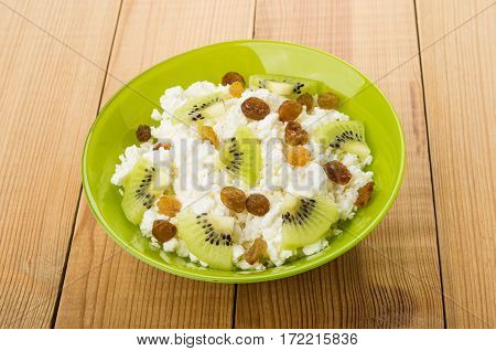 Bowl With Cottage Cheese, Raisins And Slices Of Kiwi