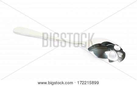 Skull shaped silver teaspoon isolated over the white background