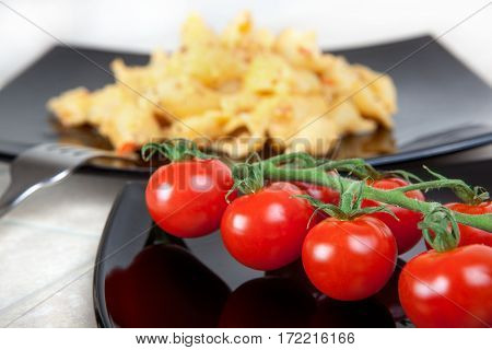 branch of cherry on a black plate. background pasta