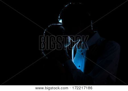 Silhouette Of Loving Couple With A Blue Light Behind