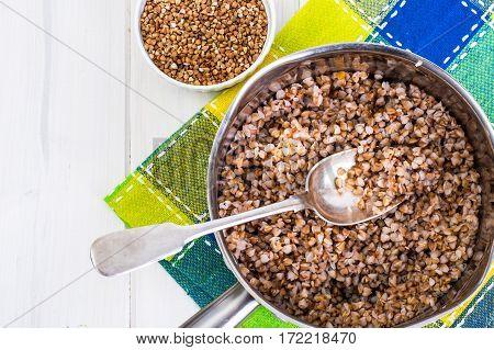 Buckwheat boiled in a metal pot. Studio Photo