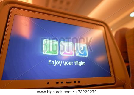 DUBAI, UAE - CIRCA NOVEMBER 2016: close up shot of a seat-back screen inside the cabin of a Emirates A380.