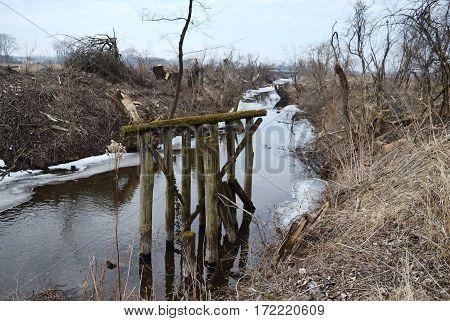 wooden bridge,Old wooden broken bridge in river water