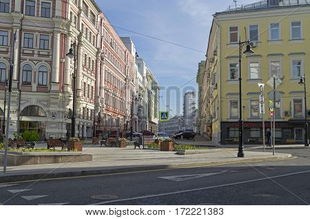 MOSCOW RUSSIA - OCTOBER 2 2016: The combination of different styles of architecture in Moscow. View through Myasnitskiy passage onto Russian Railways building on the Garden Ring.