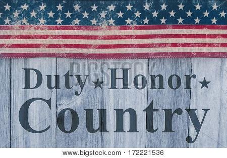 Duty Honor and Country message USA patriotic old flag on a weathered wood background with text Duty Honor Country