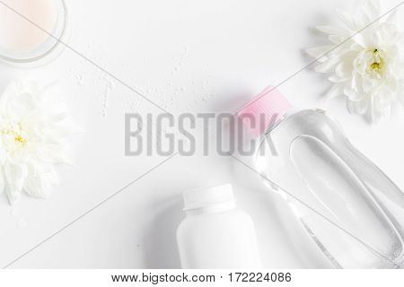 natural organic cosmetics for baby with herb on white background top view