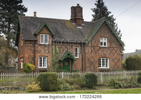 An image of a residential and detached home built in a traditional English way shot in Rockingham village Northamptonshire England UK