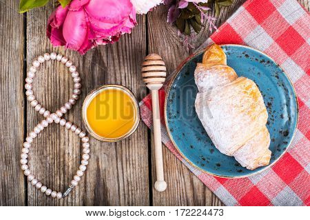 Croissants with honey for breakfast on March 8. Studio Photo