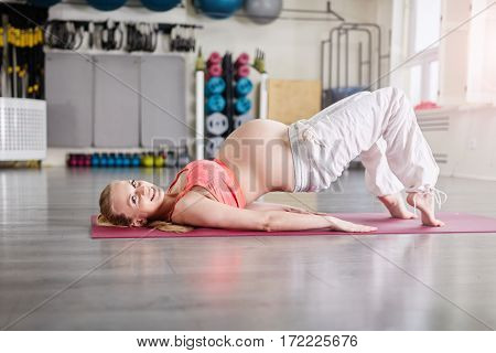Happy Pregnant Woman Training Difficult Yoga Pose