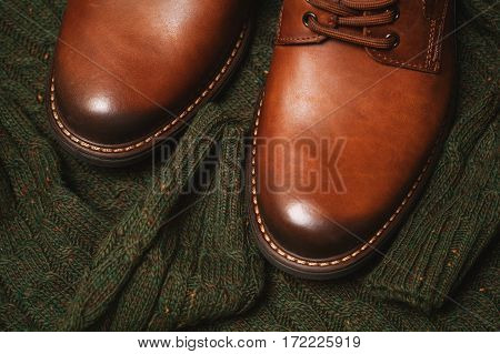 Brown luxury leather men's shoes and knitted sweater. Fashion Spring-Autumn. men's fashionable stylish clothing.