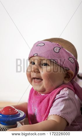 Little cute beautiful girl smiling happily playing with toys