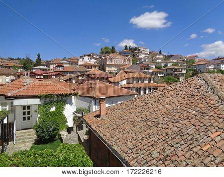 Orange tiled roofs against vivid blue sky of Ohrid, Republic of Macedonia