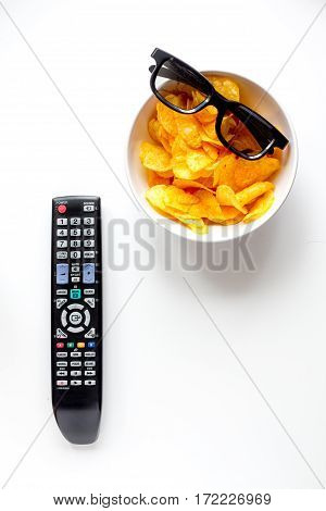 concept of watching movies with chips top view on white background